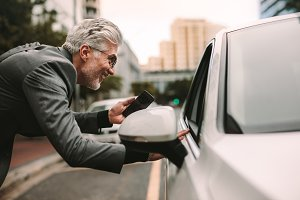 Male traveler communicating with cab
