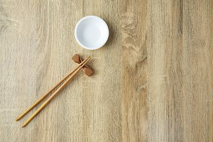 Chopsticks and white bowl