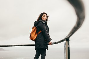 Traveling woman standing