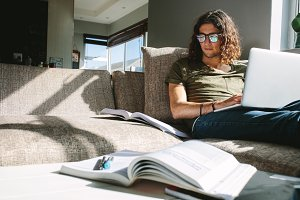 University student studying at home