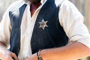 Sheriff star on the vest