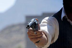 wild west cowboy aiming his gun