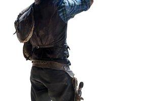 cowboy with saddlebag taking off his