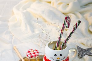 cozy soft blanket with a cup in the