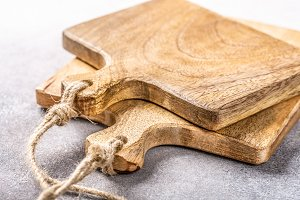 Stack of two rustic wooden cutting