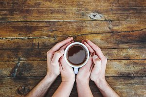 A cup of tea in the hands. Selective