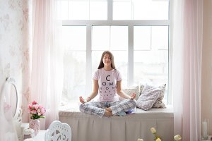 Girl in pajama meditating