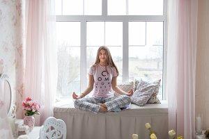 Girl in pajama meditating
