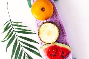 vitamin fruit set on a penny board.
