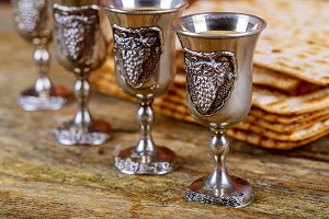 A Jewish Matzah bread four glasses