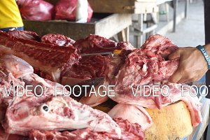Cutting Meat at a street market.
