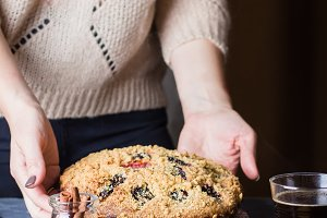 Woman holding autumn cake