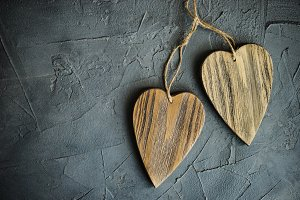 Love concept with wooden hearts