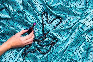 Silk green polka dot gown texture