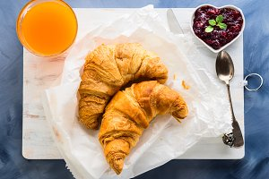 Breakfast with croissants served on