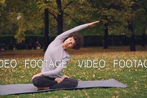 Slender girl is doing yoga exercises