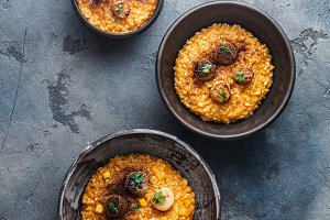 Three risotto bowls with scallops