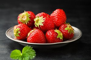 Ripe juicy strawberries on a plate