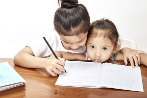 Two little girls thai homework