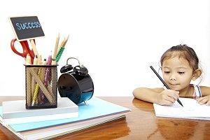 child girl thai doing homework at ho