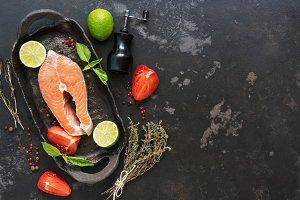 Salmon steak raw with ingredients