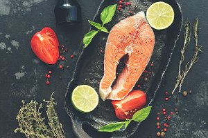 Raw salmon steak with spices