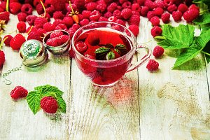 Raspberries on a wooden background.
