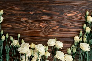 Flowers on rustic wood,design space