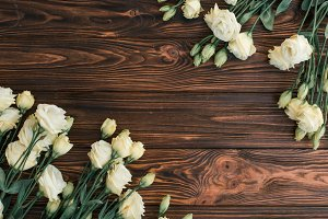 Flowers on a rustic wood flat lay