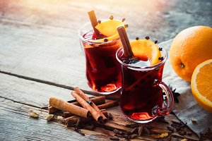 Glass mugs of mulled wine with spice