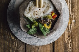Bowl of Asian Noodle Soup with chops