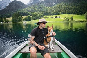 Traveller man with best friend dog