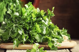 Fresh green parsley in bunch, old wo