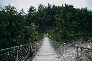 Wooden suspension bridge in moody