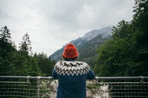 Hiker man in hipster sweater on