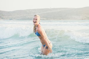 Young woman swimming in wavy waters