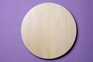 Empty wooden round tray on lilac
