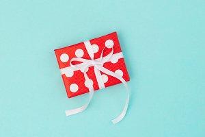 Gift box red white blue background F