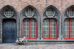 Lonely bicycle against old building