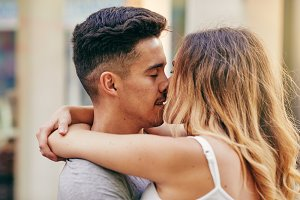 Romantic young couple kissing togeth