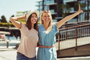 Two young friends having fun walking