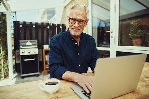 Smiling senior man enjoying a coffee