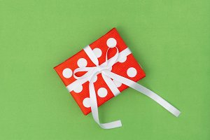 Gift box red white green background