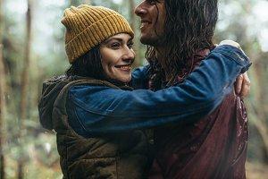 Loving couple under the rain