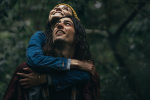 Couple at forest piggybacking