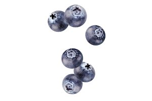 falling blueberries isolated on whit