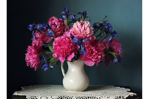 Peonies and irises in a white jug. S