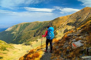 Hiker woman with backpack in Fagaras