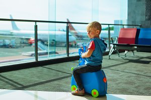 Child waiting for boarding to flight