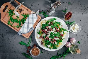 Top view on pasta dish with arugula